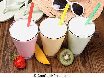 Strawberry, mango, kiwi smoothie with holiday background,...