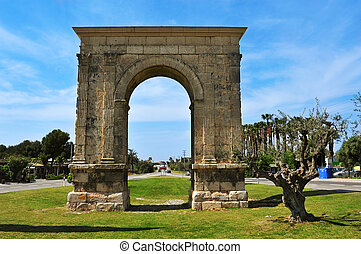a view of the Arc de Bera, an ancient roman triumphal arch...