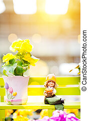 Rieger begonia and porcelain doll - A yellow rieger begonia...