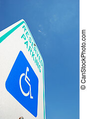 accessible - handicapped parking sign over the blue sky...