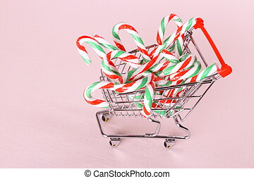Full shopping cart with candy cane