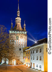 Clock Tower in Sighisoara at night - clock tower in historic...