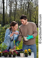 Marriage having fun in the garden during planting flowers