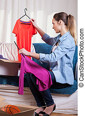 Woman packing clothes - Vertical view of woman packing her...