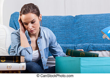 Tired woman during moving house - Tired, young woman during...