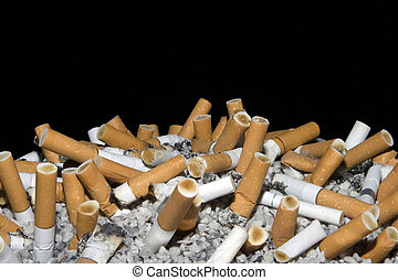 Cigarettes in ashtray isolated on black background
