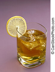 Ice-tea - Glass of ice-tea with lemon slice