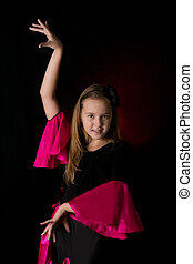 Flamenco little dancer posing isolated on black