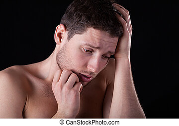 Miserable naked man - A closeup of a miserable man with no...