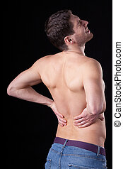 Lower back pain - A man with no top on having painful lower...