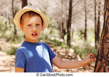 Outdoors portrait of cute 6 years old child boy