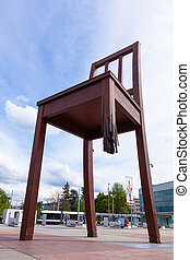 Geneva broken chair in front of the united nation building -...