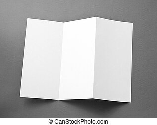 Blank folding page booklet on gray background. - Blank...