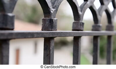 Dolly: Wrought iron fencing - Wrought iron fencing close-up...