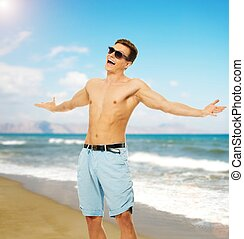 Cheerful young man on a beach