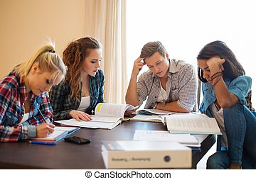 Group of students preparing for exams in apartment interior...