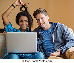 Young multi ethnic students couple preparing for exams in...