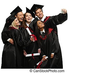 Multi ethnic group of graduated young students taking selfie...