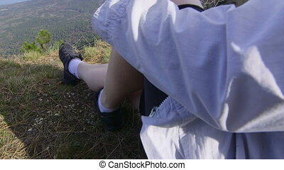 Female hiker with smartphone at mountain top Ai-Petri...