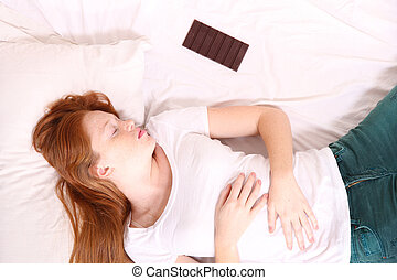 Sleeping - A young adult Woman sleeping on bed with a...
