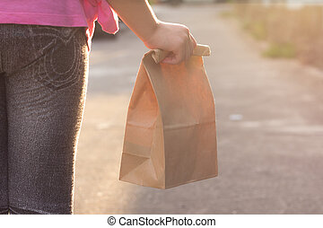 Child walking to school, with lunch bag - Child walking to...