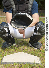 baseball catcher showing secret signal gesture