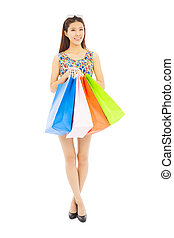 happy young woman holding shopping bags