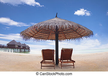 water villa with umbrella and beach chair .maldives