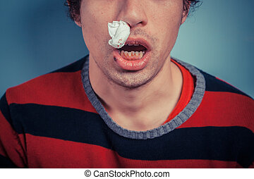 Man with nose bleed and cold sores