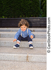 Happy toddler boy on stairs - Happy toddler on stairs trying...