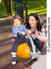 Mother and son having fun in park - Mother and toddler son...