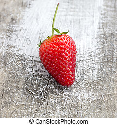 Fresh, ripe strawberries on the old board, close up