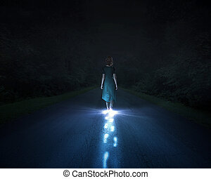 Light walking - A woman walking at night and leaving bright...