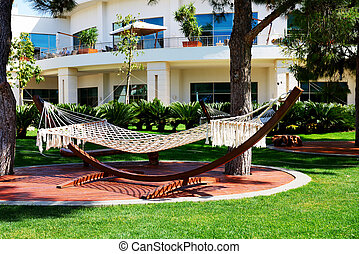 The hammock is on lawn in luxury hotel, Antalya, Turkey