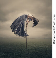 Tied to the earth - A woman is being pulled towards the sky,...