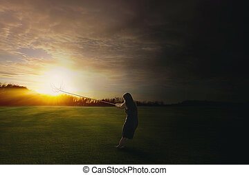 Pulling the sun to the darkness - A woman pulls the bright...