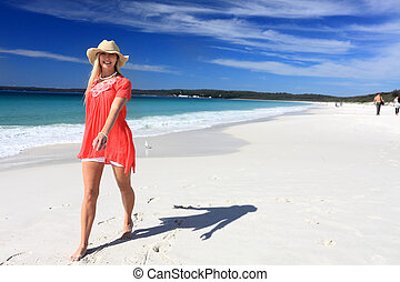 Happy woman walking along beautiful beach - Happy woman...