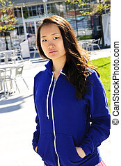 Asian woman - Young korean woman at outdoor mall in blue...