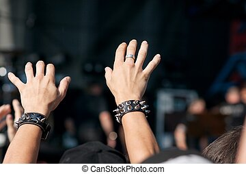 Concert - Hand over the crowd at an openair rock festival