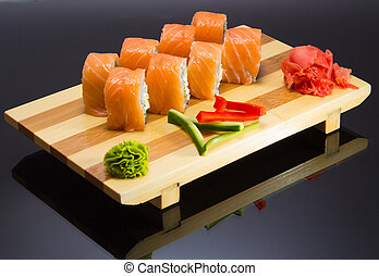 sushi mde dish over black background
