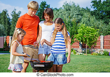Happy family with barbecue - Happy family on vacation having...