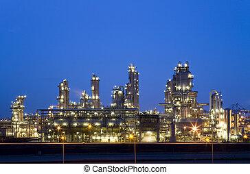 refinería, noche