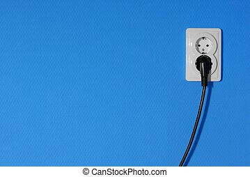 Electricity - Electric outlets on a blue wall