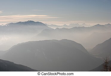 Mountains - Mountain range covered in a fog