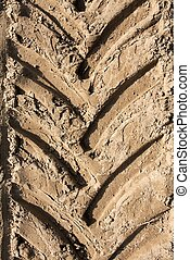 Tractor trail closeup on the soil