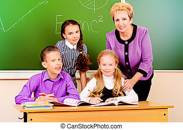 group of pupils - A teacher and her students during class at...