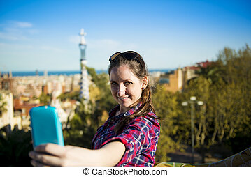 Woman tourist - Pretty young female tourist takes selfie in...