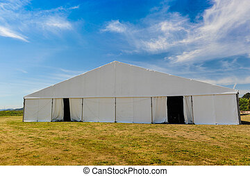 Large white party tent if a field