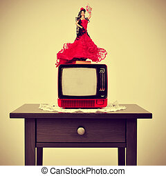 an old-fashioned spanish living room, with a flamenca doll...