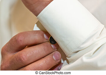 Man Putting on Cufflink